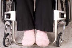Legs in a wheelchair Stock Photos