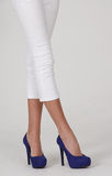 Legs in White Capris Blue Heels Royalty Free Stock Images