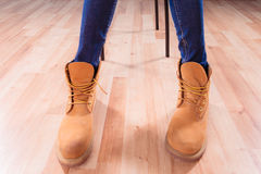 Legs in winter boots Stock Photography