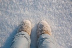 Legs, winter boots on snow Royalty Free Stock Image