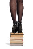 Legs of woman with books Stock Images