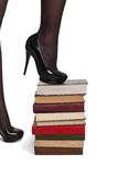 Legs of woman with books Stock Image
