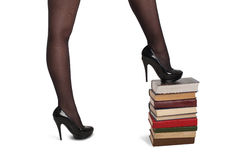 Legs of woman with books Stock Photos