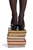 Legs of woman with books Stock Photo