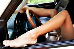 Legs of a woman in a car royalty free stock photos