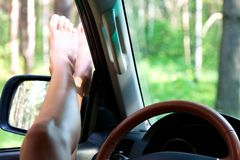 Legs of a woman in a car stock photography