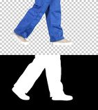 Legs of woman construction worker walking, Alpha Channel royalty free stock photos