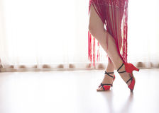 Legs of woman dancing. Woman dancing latin rhythms Royalty Free Stock Photo