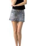 Legs of woman in denim skirt Royalty Free Stock Photography