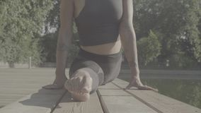 Legs of woman doing yoga asana - hanumanasana stock video footage
