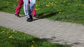 Legs of woman and girl walking on the track stock footage