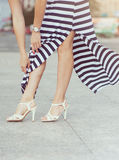 Legs of woman with high heels Stock Photos