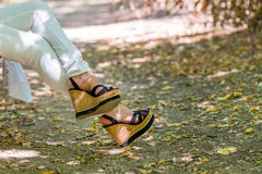 Legs of woman in high platform shoes Royalty Free Stock Images