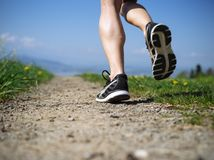 Legs of a woman jogger in the country Stock Image