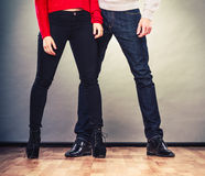 Legs of woman and man. Feet in footwear shoes. Romantic couple in love. Legs of women and man. Feet in footwear shoes indoor Royalty Free Stock Photo