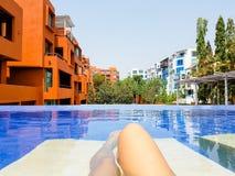 Legs of woman in pool