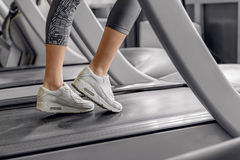 Legs of woman running on treadmill Stock Photography
