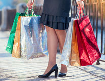 Legs of woman with shopping bags in the city Royalty Free Stock Photography