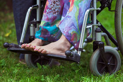 Legs of woman sitting in wheelchair royalty free stock images