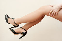 Legs of woman with stilettos shoes Royalty Free Stock Images