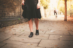 The legs of a woman walking in alley Royalty Free Stock Photo