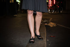 Legs of woman walking streets at night Stock Photography