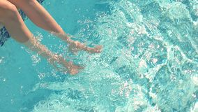 Legs of woman in water. stock video
