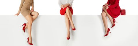 Legs Woman Wearing High Heels Shoes Sitting On Bench. Stock Photography