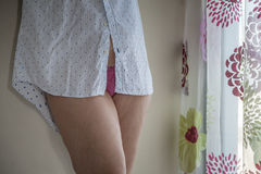 Legs of woman by the window Stock Image