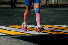 Legs women athletes in compression socks. And taping knee running sports race stock photography