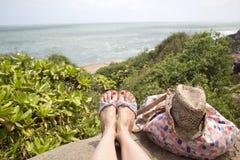 Legs of women. On beach Stock Image