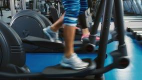 Legs work on elliptical trainer.  stock footage
