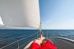 Legs of the yachtsman Royalty Free Stock Image