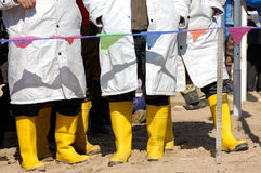 Legs in yellow rubber boots Stock Image