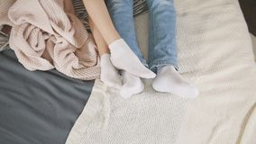 Legs of young attractive couple cuddling and waking up together, family relationships. Top view Royalty Free Stock Photos