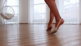 Legs of young ballerina spinning around stock video