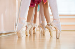 Legs of young ballerinas standing on pointe in row Royalty Free Stock Photos