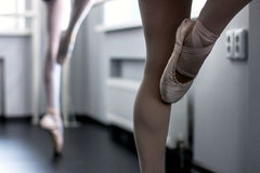 Legs of young ballet dancers stock image
