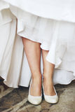 Legs. Of a young bride in elegant shoes Stock Photography