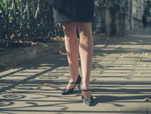 Legs of young businesswoman in the park Stock Photography