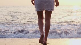 Legs young Caucasian female healthy outdoor lifestyle walking beach coast tropical living travel barefoot ocean shallows.  stock video