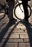 Legs of a young couple face to face with bicycle Royalty Free Stock Photos
