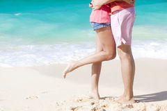 Legs of young couple on tropical turquoise boracay beach Royalty Free Stock Photos
