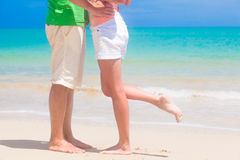 Legs of young couple on tropical turquoise Stock Photos