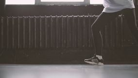 Legs of the young hip hop dancer. The action in slow motion stock video