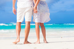 Legs of young kissing couple on tropical turquoise Stock Photography