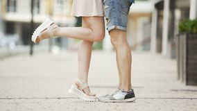 Legs of young man and woman approaching each other, romantic relationship, date. Stock footage stock video footage