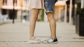Legs of young man and woman standing close to each other, romantic relationship Royalty Free Stock Photography