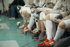 Legs of young participants of fencing competition