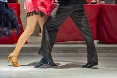 Young people dancing latin. Legs of a young people who dance in dance competition Royalty Free Stock Photo